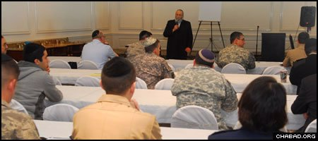 Rabbi Sholom B. Lipskar, founder of the Aleph Institute, leads a session for Jewish soldiers at a past conference sponsored by the organization.
