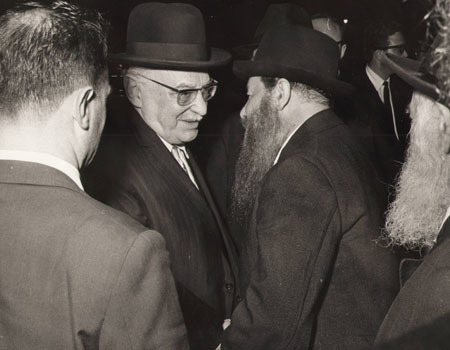 Elder group of Chassidim, disciples of the Rebbe, greet Shazar in his hotel room.
