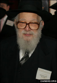 Rabbi Chaskel Besser was photographed as an attendee at one year's International Conference of Chabad-Lubavitch Emissaries.