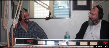 Rabbi Pinchas Ezagui, right, hosts a Sunday morning talk show on WNDB 1150 AM, on-air home of the annual Daytona 500 stock car race.
