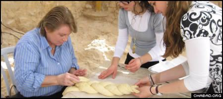 Leslie Larsen, 60, makes a loaf of challah bread as part of her Bat Mitzvah ceremony atop the ancient Judean Desert fortress of Masada.
