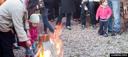 Jewish children and their parents enjoy a bonfire in celebration of Lag B'Omer last year in Poland.