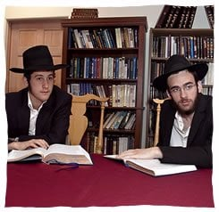 Aleph Institute volunteers, Peretz Schapiro and Dov Kalmensohn, during their travels to prisons across six states. (Photo by Paul Ross)
