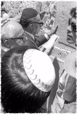 Prime Minister Menachem Begin (center, touching the stones) at the Western Wall, shortly after he was informed that he would be the next prime minister of Israel. (Photo: Ya'acov Sa'ar/Israel National Photos)