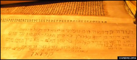 An inscription on the back of a 175-year-old Torah scroll being dedicated at Chabad-Lubavitch of Port Washington, N.Y., on July 25 testifies to its authorship. When he purchased it for his son, Menashe Shurka had no idea that it was written by the boy's great-great-great-great-grandfather.