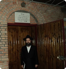 The author standing outside the resting place of Rabbi Schneur Zalman of Liadi in Hadich, Ukraine.