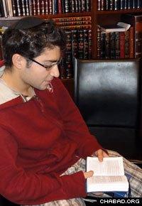 Solomon Braun prays at the Chabad House.