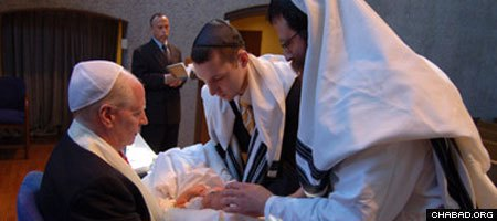 Rabbi Levi Heber of Brooklyn, N.Y., circumcises a child at a traditional ceremony known as a bris.