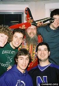 Rabbi Dov Hillel Klein, center, celebrates the holiday of Purim with Northwestern students.