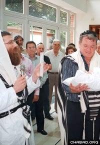 Rabbi Levi Heber, left, founded the International Bris Association.
