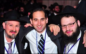 The 27th annual International Banquet of Chabad Lubavitch Emissaries. Pictured (L to R): Rabbi Yossel Kranz of Chabad of Virginia, Neil Ackerman and Rabbi Mendy Weiss of Chabad of Virginia.