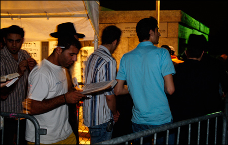 The line to enter the gravesite of the Rebbe.