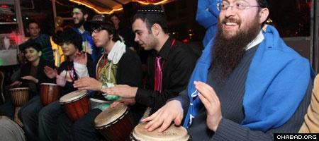 A drum circle celebrates the close of the Jewish Sabbath aboard a yacht as part of the National CTeen Shabbaton. (Photo: Bentzi Sasson)