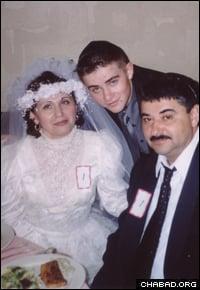 Avrohom (Alexander) Denisov with his parents at their Jewish wedding