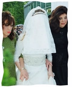 Blumi Lazar is escorted to her wedding by her mother Chani, left, and her mother-in-law, Rivka Rosenfeld.