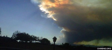 Smoke from the Los Alamos wildfire blocks the sun 40 miles outside of Santa Fe, N.M.