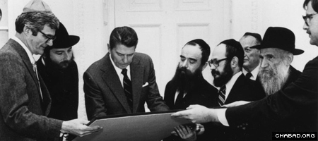 With Rabbi Abraham Shemtov, fifth from right, by his side, President Ronald Reagan reviews a proclamation in honor of the Lubavitcher Rebbe's 86th birthday. (Photo: Lubavitch Archives)