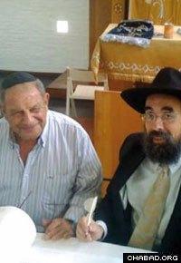 Rabbi Eliezer Shemtov, right, directs Chabad-Lubavitch of Uruguay.
