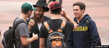 Chabad-Lubavitch Rabbi Chaim Goldstein engages Drexel University students in West Philadelphia.