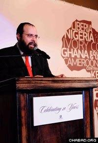Rabbi Shlomo Bentolila speaks at Chabad-Lubavitch of Central Africa's gala dinner.