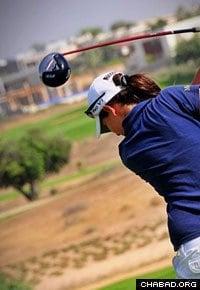 Laetitia Beck swings at the 2010 Caesarea Golf Club Championship. (Photo: Yoav Etiel/Hamoshavot Magazine)