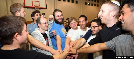 Rabbi Dovid Gurevich, center, of the Chabad House at UCLA and Jewish basketball player Tamir Goodman, second from right, party with Jewish students at the annual West Coast Jewish Student Summit.