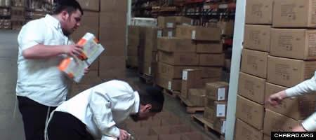 Volunteers fill Passover care packages at a New Jersey warehouse on behalf of the Aleph Institute.
