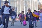 Teachers Make Chanukah Visits To More Than 800 Families