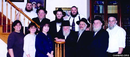 """Rabbi Yosef (""""Uncle Yossi"""") Goldstein (center) with his family."""