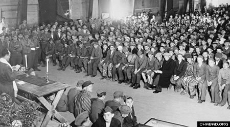 Rabbi Herschel Schacter (left) conducts the service of the first day of Shavuot for survivors of the Buchenwald concentration camp shortly after their liberation.