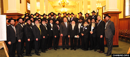 Rabbi Moshe Herson, center right, director of Chabad-Lubavitch in New Jersey, with Steven Sweeney, center, president of the New Jersey State Senate, and Chabad-Lubavitch emissaries to New Jersey.