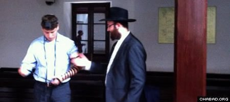 Avner Netanyahu after turning to Rabbi Avraham Greenberg, co-director of Chabad-Lubavitch of Pudong, and asking him if he happened to have tefillin.