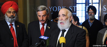 Rabbi Israel Rubin speaking out in support of a new religious freedom law sponsored by New York Assemblyman David Weprin (center).