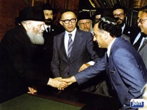 The Rebbe greets Avner at a Yechidus with Menachem Begin in 1977
