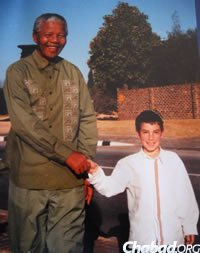 Nelson Mandela with one of the Goldmans' sons when the boy was about 9.