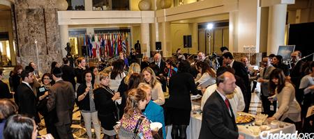 """Guests mingle at """"A World of Light"""" Chanukah event for the Washington, D.C., international community. (Photo: Len De Pas)"""