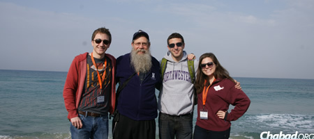 With students on the coastal shores of the Mediterranean.