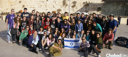 Rabbi Dov Hillel Klein, lower left, with students at the Kotel in Jerusalem during a previous Birthright Israel trip.