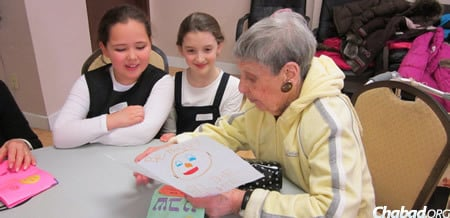 Ahead of their visit, the girls decorate cards to give to their new acquaintances and practice Jewish songs they will perform for the seniors.
