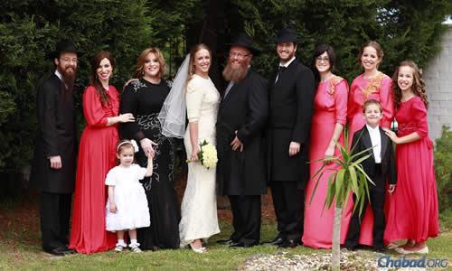 The Barber family outside Mrs. Rivki Barber's home in Australia, two years ago before her daughter Chanie's wedding.