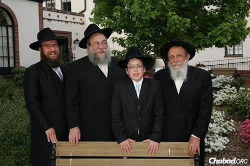 Rabbi Zalman I. Posner, right, at the bar mitzvah of his oldest great-grandchild, Menachem Mendel Deren, center, and from left, his grandson, Rabbi Yossi Deren, and son-in-law Rabbi Yisrael Deren.