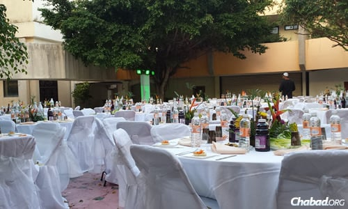 The tables are set for the Seder at Chabad in Cancun, Mexico.