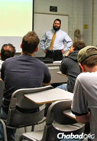 The rabbi teaches a wide range of students from various faiths.