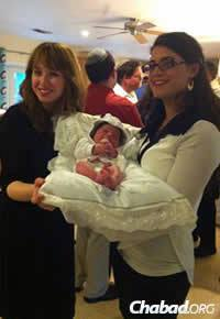 Rikal Pewzner, co-director of Chabad of the Cayman Islands, at the recent brit milah of local resident Liat Arubas's baby son, Gabriel