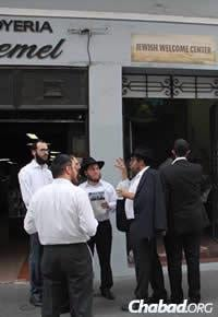 """Chabad rabbis at a conference in Puerto Rico earlier this month linger outside the """"Jewish Welcome Center"""" in Old San Juan."""