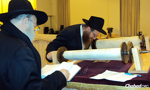 This Torah rests on a special stand made to easily roll the parchment so that the sofer can examine the letters.