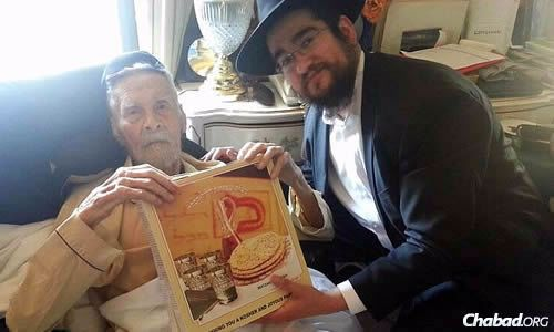 Rabbi Pinny Marozov and Alexander Imich at the older man's apartment in April, shortly before Passover and the last visit they shared.