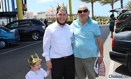Purim came to the island in royal form: Rabbi Blasberg and his son deliver mishloach manot gifts of holiday treats.