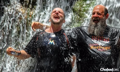 Mayanot participant Mitch Green, left, and the rabbi cool off at Ein Gedi in the south of Israel. (Photo: Nisan Hanania)