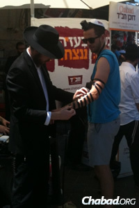 The mitzvah of tefillin is especially important right now, says the rabbi.